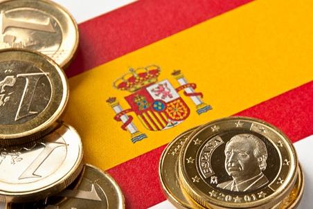 Евро и флаг Испании